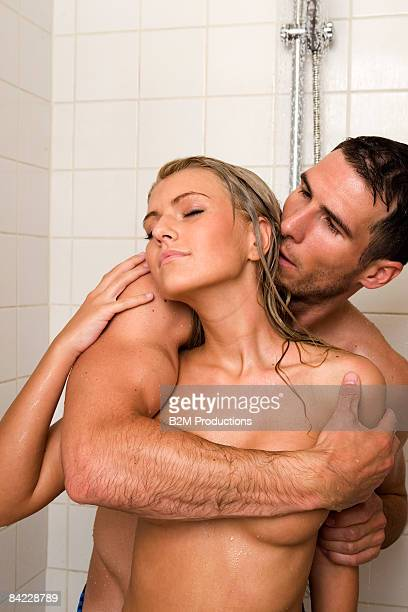 Nude couples under shower