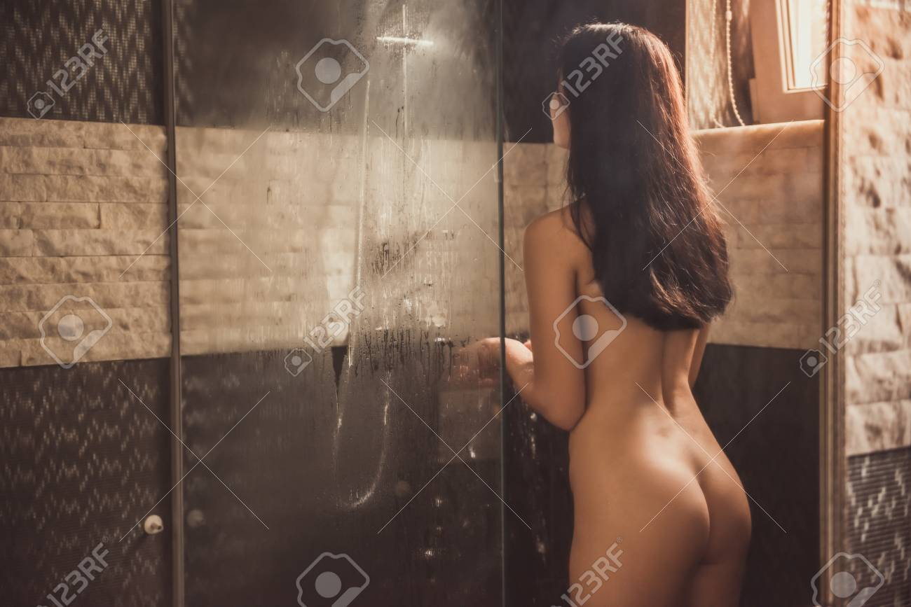 Woman taking a shower nude